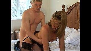 Sexy British wife Alex in black stockings gets fucked on the bed