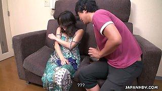 Giggling happy Japanese brunette Hosaka Yuriko gets her juicy boobs sucked