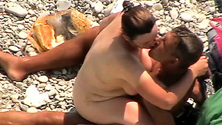 Voyeur video of hot pussy spreads at the beach