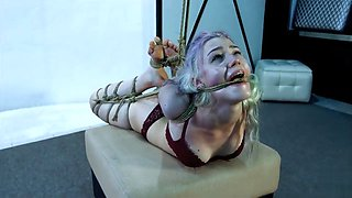 Cute girl in tight bondage crying for mercy