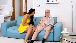 Dark-haired hottie visits an old man relaxing on couch