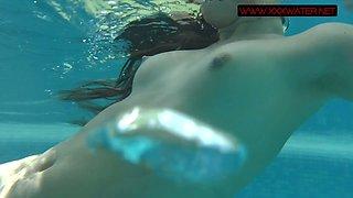 Russian mermaid Mia Ferrari performs hot underwater striptease show