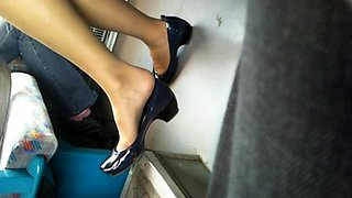 Voyeur spying on a hot babe with sexy legs and lovely feet